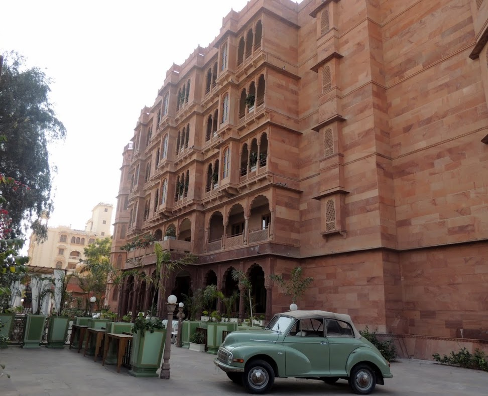 Front view of Narendra Bhawan with vintage car in foreground